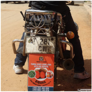 Sample message on a motorbike flap in Tanzania